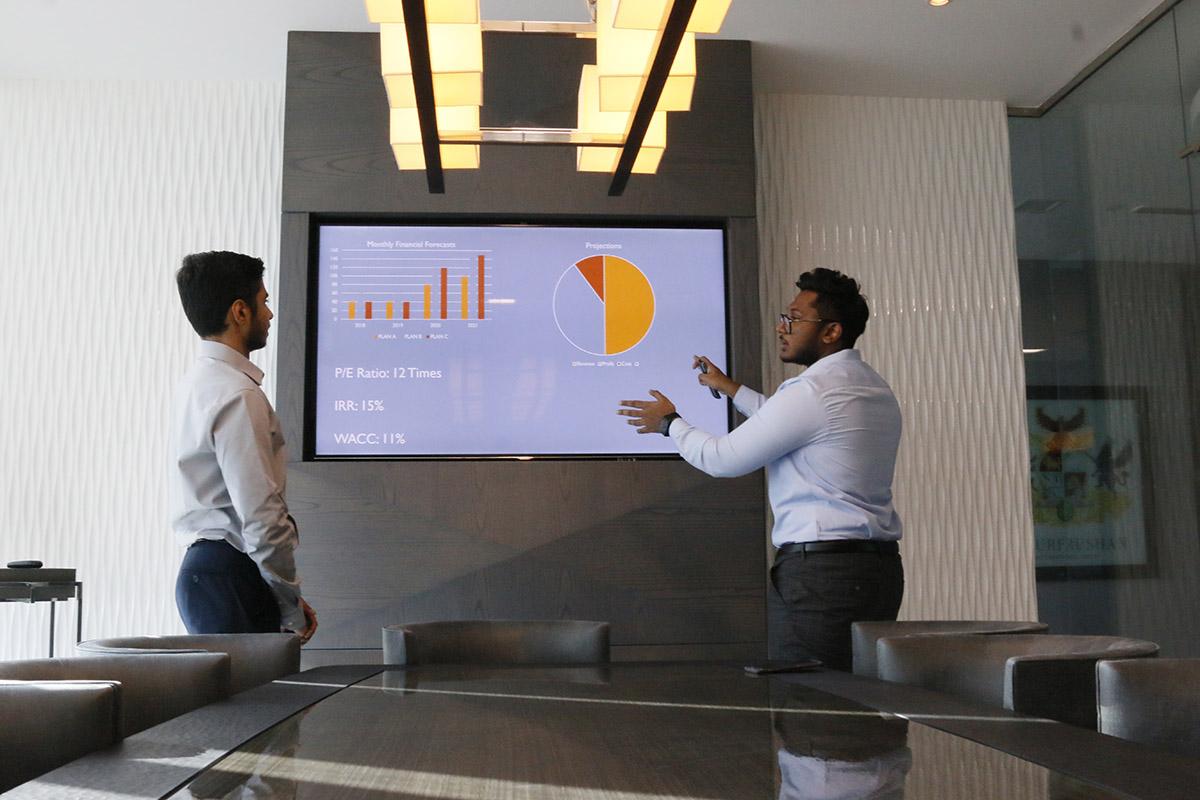 V7 Group team members presenting graphs